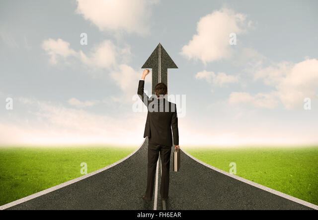 Businessman lokking at 3d road upgoing arrow - Stock Image