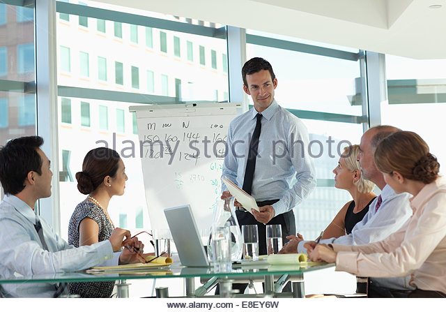 Business people talking in meeting - Stock-Bilder