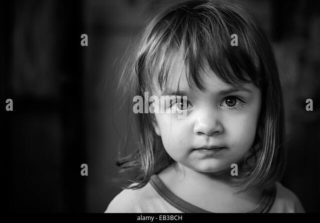 portrait of girl (2-3) with big beautiful eyes - Stock Image