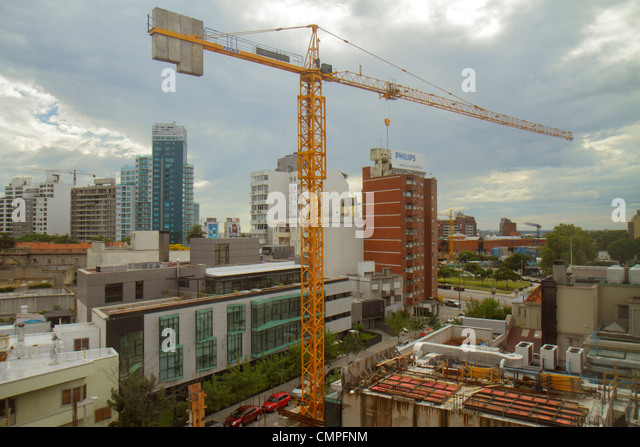 Uruguay Morales Montevideo Tres Cruces view from Hospital Británico under construction crane building - Stock Image