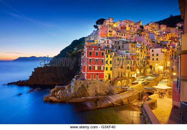 Riomaggiore at evening dusk, Cinque Terre, Liguria, Italy - Stock Image