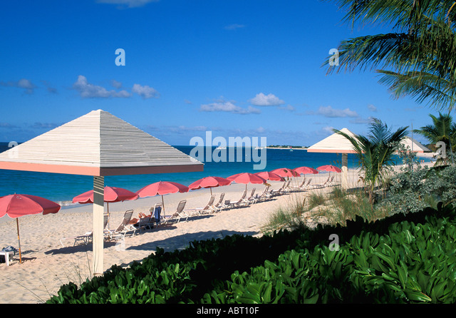 Caribbean beach chairs and umbrellas Grace Bay Turks Caicos Islands Providenciales - Stock Image