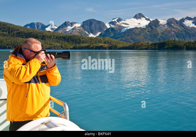 Visitor aboard Klondike Express 26 glacier cruise day trip view the glaciers in College Fjord, Prince William Sound, - Stock Image