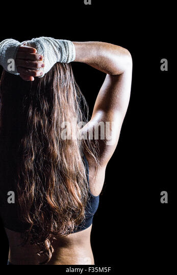 Rear view of female boxer with long brown hair - Stock Image