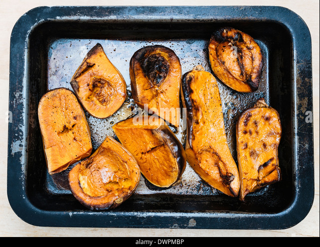 Roasted butternet squash in a pan - Stock Image