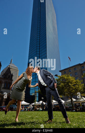 Couple Kissing in front of John Hancock Tower, Copley Square, Boston, USA - Stock Image