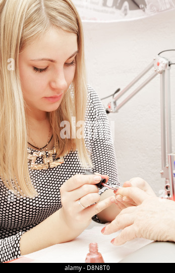 Beautician at work - Stock Image