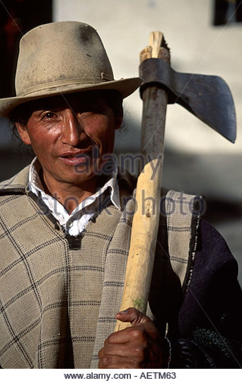 Ecuador Cotacachi man resident axe Indigenous Hispanic - Stock Image