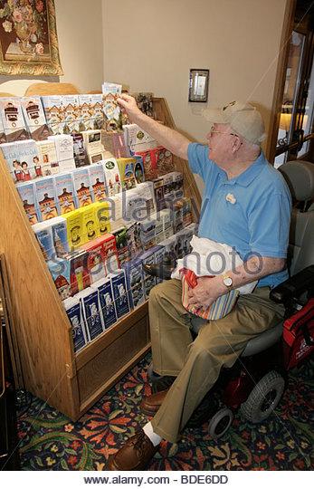 Michigan Frankenmuth Bavarian Inn Lodge hotel electric wheelchair lobby man disabled brochures kiosk information - Stock Image