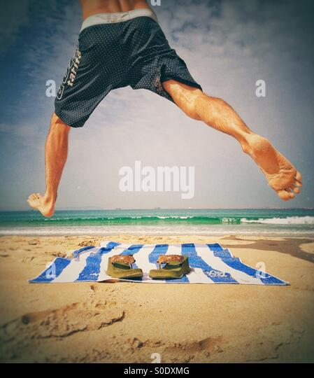 Man enjoying at the beach - Stock Image