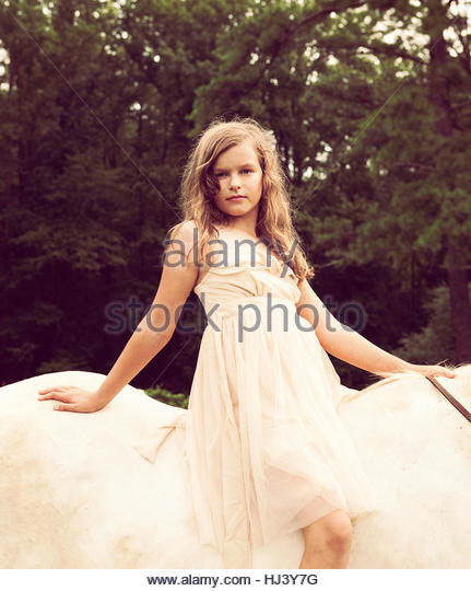 Young girl on a Horse - Stock Image