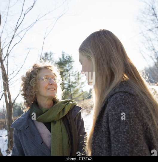 Two women outdoors wearing warm clothes against the cold. Mother and daughter. - Stock Image