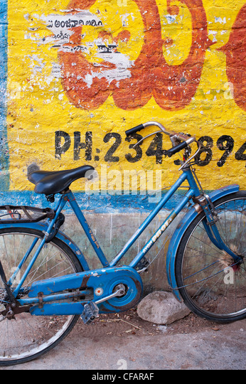 Traditional Indian womans bicycle against a yellow painted wall. Andhra Pradesh, India - Stock-Bilder