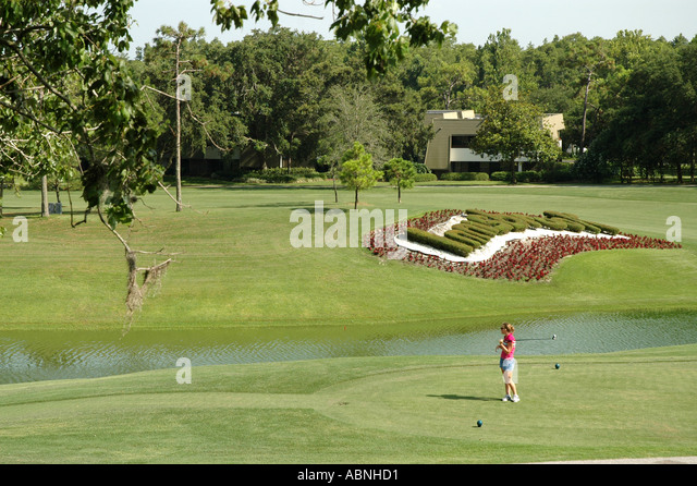 Tarpon Springs Florida Westin Innisbrook Resort Copperhead Golf Course woman golfer red shirt - Stock Image