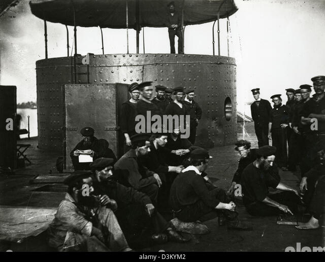 Undated photograph showing the crew of ironclad warship the USS Monitor relaxing just outside of its turret. The - Stock-Bilder
