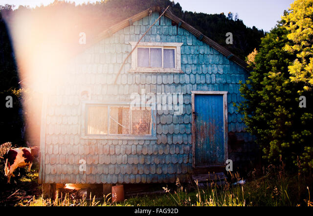 Traditional Alerce (Cypress Pine) subsistence farming homestead on the shore of Reloncaví Sound in Chile's - Stock Image
