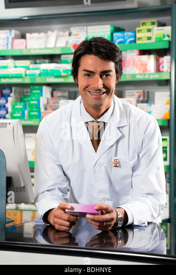 portrait of mid adult pharmacist looking at camera - Stock Image