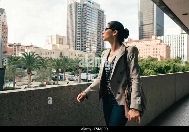 Businesswoman looking out from walkway, Los Angeles, USA - Stock Image