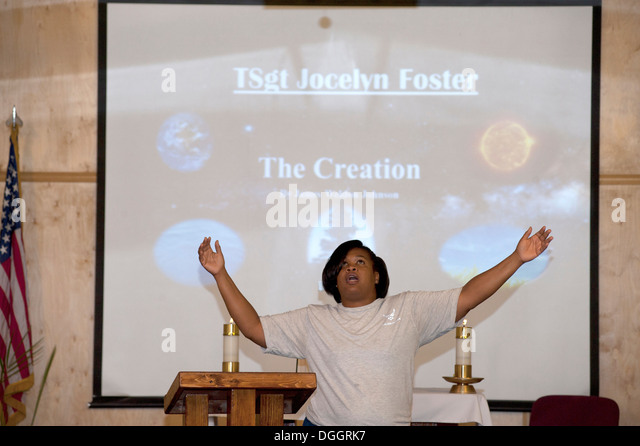 Tech. Sgt. Jocelyn Foster tells a poetic story of 'The Creation' based on the creation account in the book - Stock Image