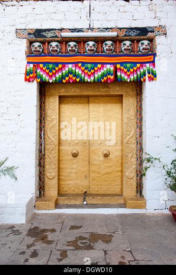 Tibetan Buddhism, gold-studded door, gate, entrance, fortress-monastery, Dzong, Punakha, the Himalayas, Kingdom - Stock Image