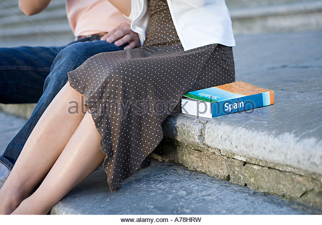Couple sat on step - Stock Image