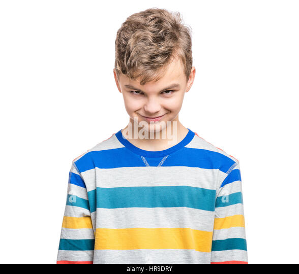 Teen boy making silly grimace - expressing cunning face. Upset child isolated on white background. Emotional portrait - Stock Image