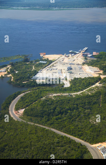 Aerial view of rainforest cleared for industry along the Rio Negro, Manaus, Amazonas, Brazil, South America - Stock Image