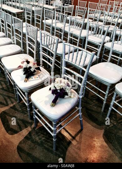 Wedding bouquets on chairs at wedding ceremony. - Stock-Bilder