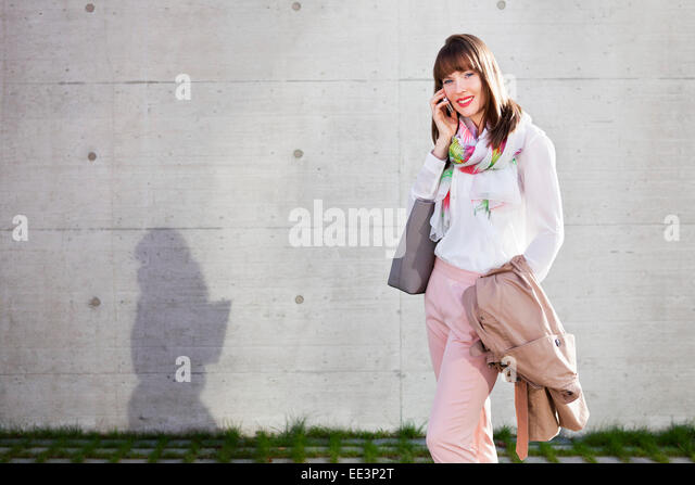 Young woman outdoors, Munich, Bavaria, Germany - Stock-Bilder
