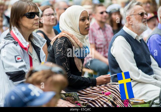 Immigrants and native Swedes participating in National day celebrations in Norrkoping, Sweden. - Stock Image