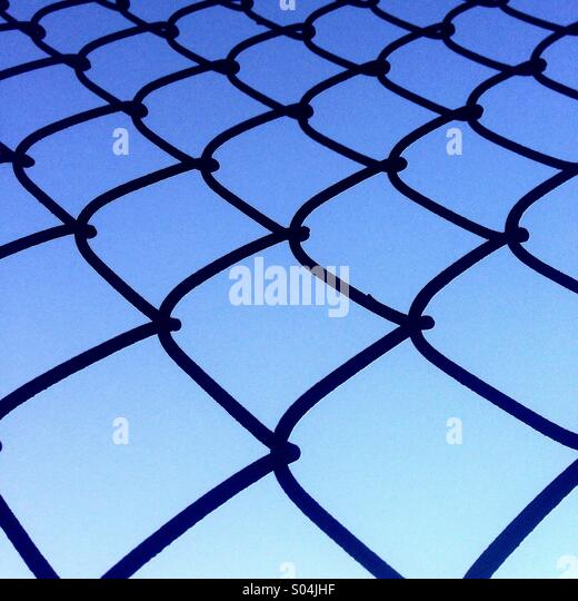 Sky through the wire - Stock Image