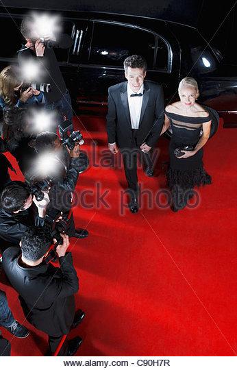 Celebrities walking on red carpet - Stock Image