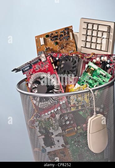E-waste in a waste bin - Stock Image
