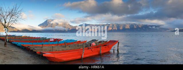 Boats on Lugu Lake at dawn, Yunnan, China - Stock Image