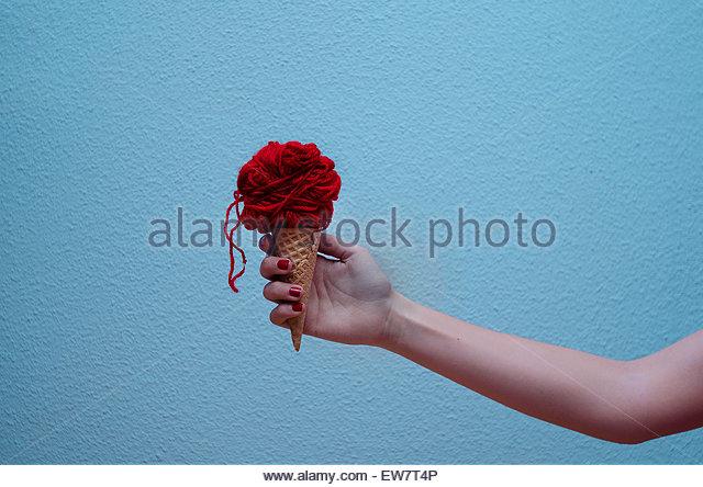 Woman holding a conceptual ice-cream - Stock Image