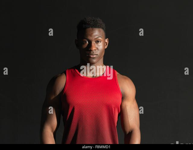 Portrait of athlete, black background - Stock-Bilder