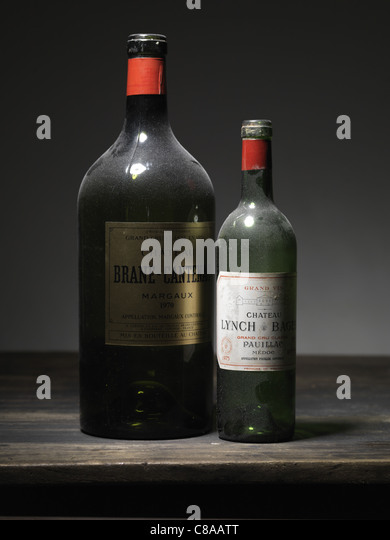 Two bottles of red Bordeaux wine - Stock Image