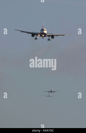 Air traffic - three airliners in a queue for landing - Stock Image