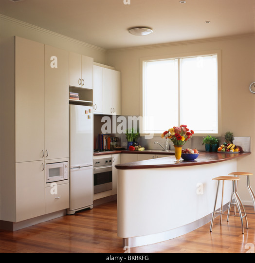 White Kitchen Units With Oak Worktop: Interiors Kitchens Fridges Refrigerators Stock Photos