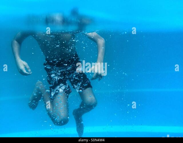 Little boy swimming in the pool Beirut Lebanon - Stock Image