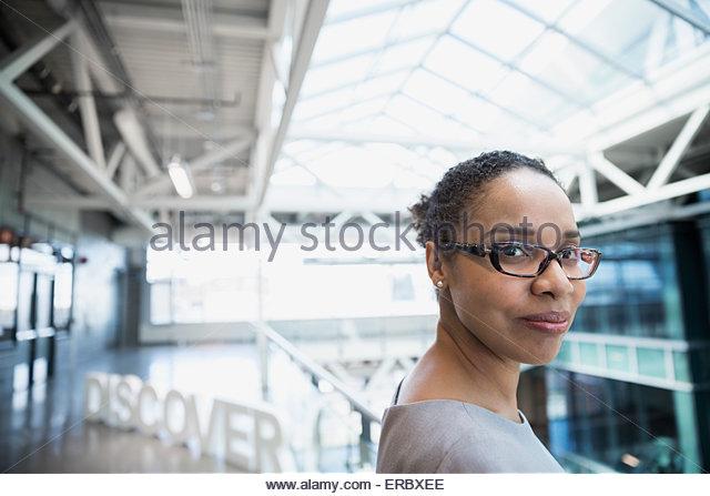 Portrait confident businesswoman near 'Discover' text atrium - Stock Image