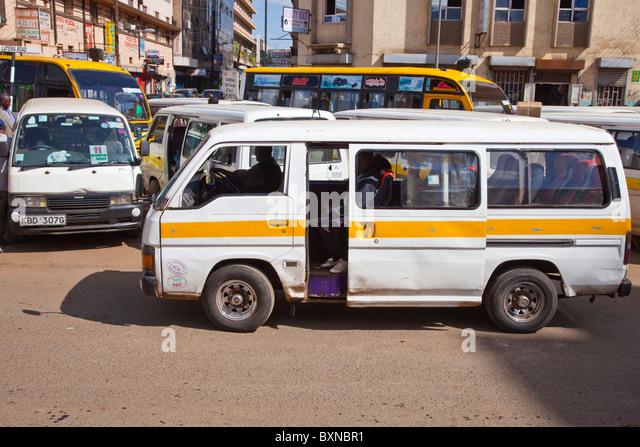 Matatu or minivan terminal in downtown Nairobi, Kenya - Stock Image