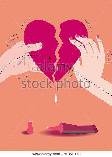 Man and woman gluing broken heart together - Stock-Bilder