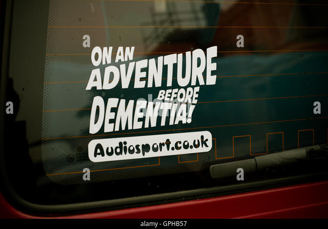 Audiosport.co.uk sticker on the back window of a VW van 'On an Adventure before Dementia!' - Stock Image