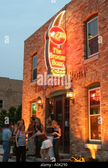 Toledo Ohio Huron Street The Bronze Boar nightlife men women talking - Stock Image