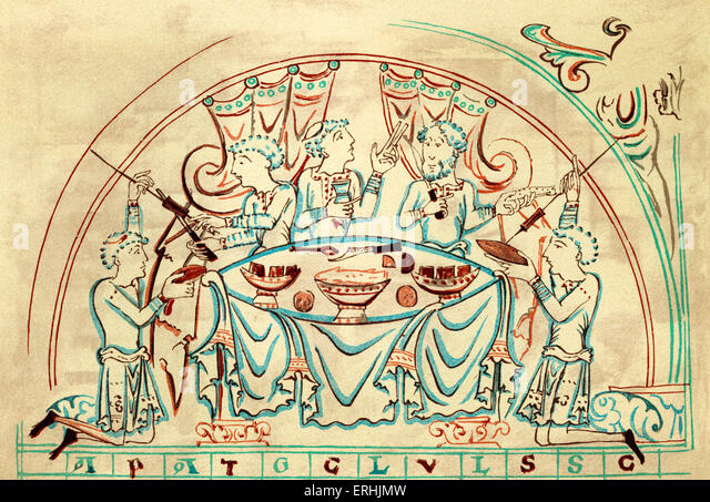 A banquet. 11th century. A group of people feasting at a table. - Stock Image