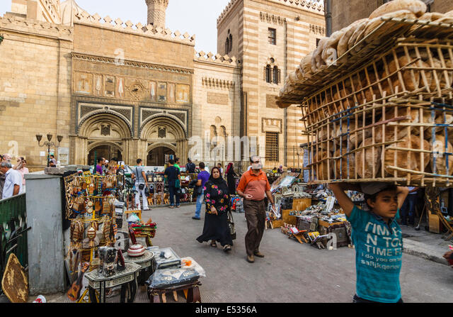Child selling bread by Al-Azhar mosque. Cairo, Egypt - Stock Image