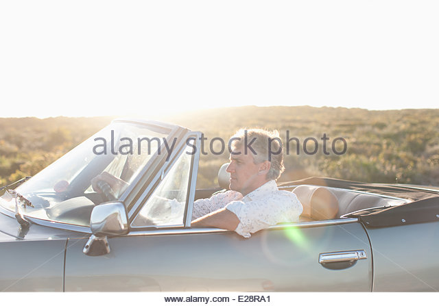 Man driving convertible - Stock Image