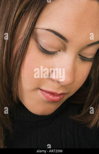 Woman looking downward - Stock-Bilder