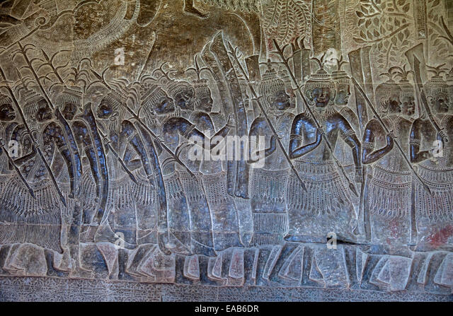 Cambodia, Angkor Wat.  Bas-relief Stone Carving Depicting Scenes from the Mahabharata, Corridor on West Side of - Stock Image